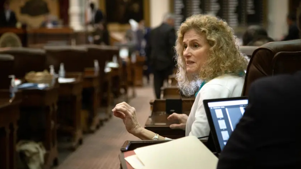 State Rep. Donna Howard, D-Austin, speaks to a colleague on the House floor at the state Capitol.