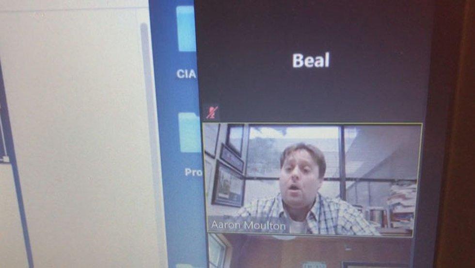 Dr. Aaron Moulton, an SFA assistant professor, teaches an online course via Zoom, a...