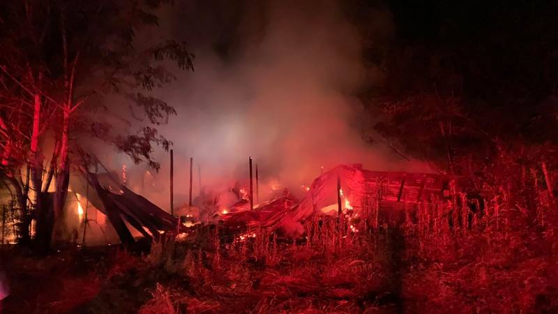 Hot spots continue to burn as fire crews tame a large barn fire in Rusk County.