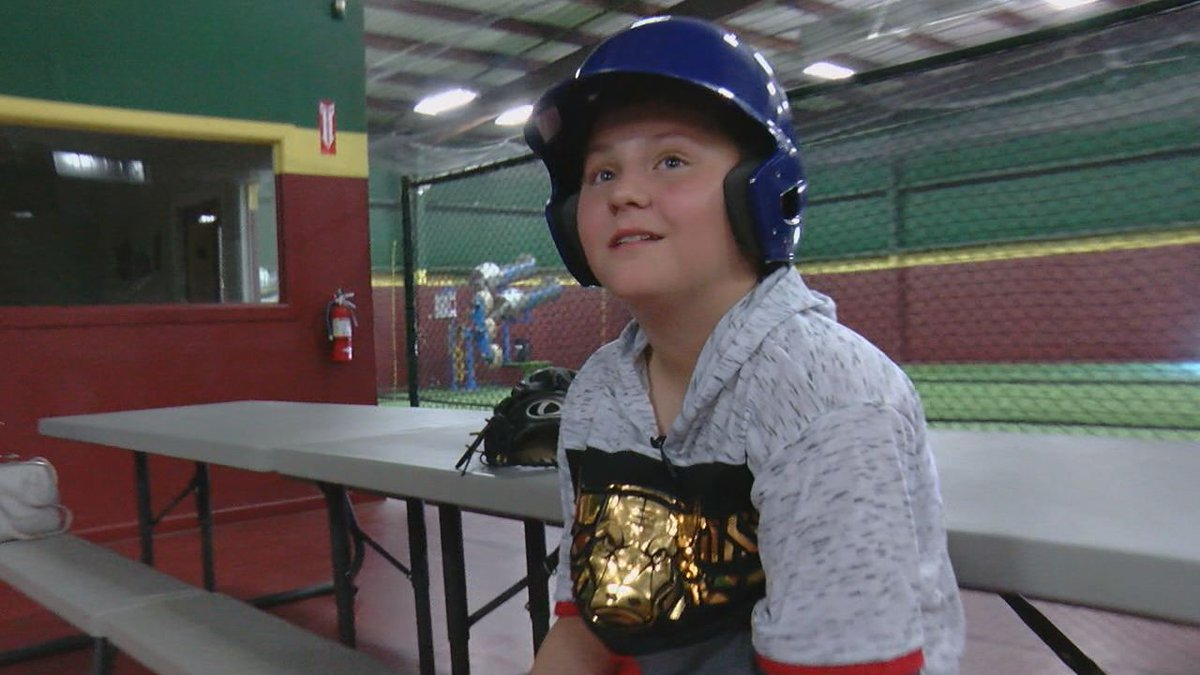 Ryan, 11, waits to get into the batting cage at D-Bats Tyler.