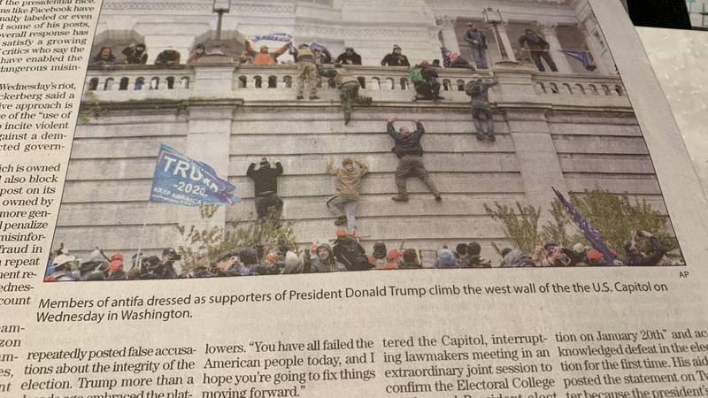 """A Tyler newspaper caption stated """"""""Members of antifa dressed as supporters of President Donald..."""