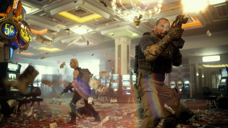 """Nora Arnezeder (left) and Dave Bautista in the movie """"Army of the Dead."""""""