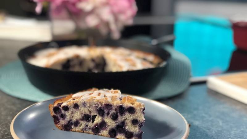 This cake is full of juicy berries, has a dense, moist texture, and a light glaze tops it off...