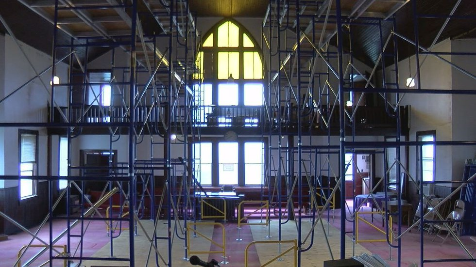 Scaffolding now supports the roof of the sanctuary of 1920s church building. (Source: KLTV staff)