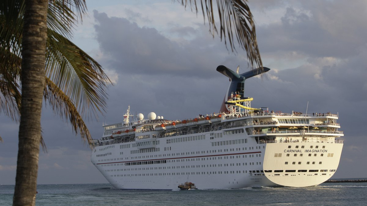 The Carnival Imagination cruise ship passes South Pointe Park  in Miami Beach, Fla.  as it...