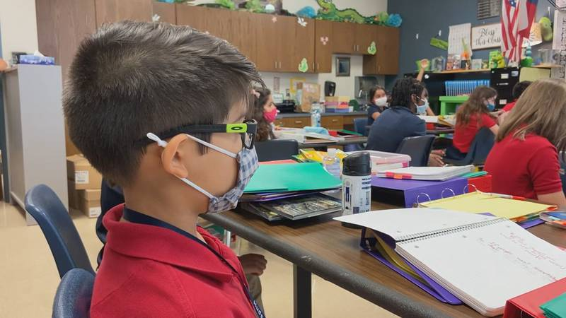 A Longview ISD students sits in a class with a mask on following the issuance of the district's...