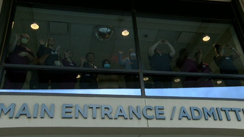 Hospital staff waved to the community during the show of support, Sunday night.