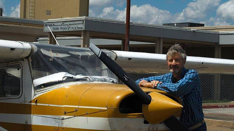 Keith McElvain stands with his plane.