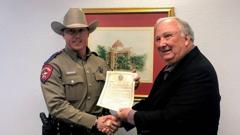 DPS Trooper accepts a resolution honoring him for the rescue of a mother and child on the...