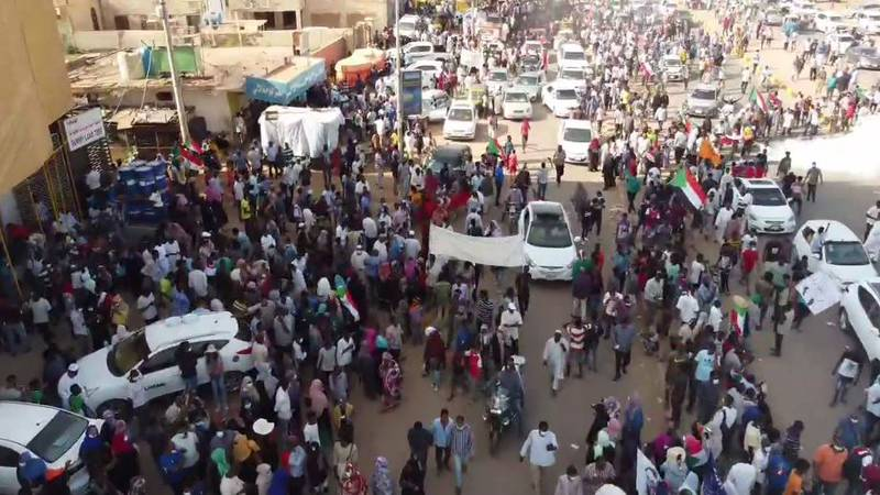 FILE - Thousands of Sudanese protesters took to the streets Thursday, Oct. 21, 2021, to voice...