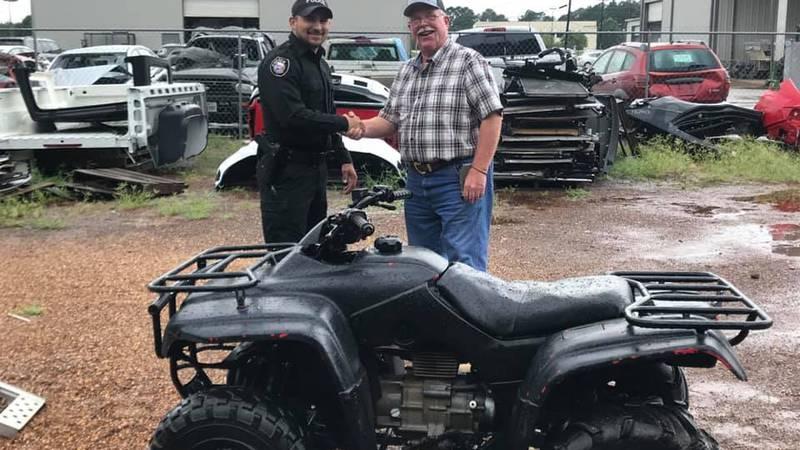 """Crocket Police share a handshake with """"Mr. Hendricks"""" after returning stolen ATV."""