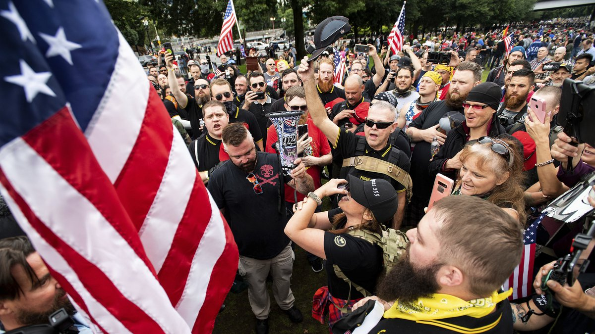 In this Aug. 17, 2019, file photo, members of the Proud Boys and other right-wing demonstrators...