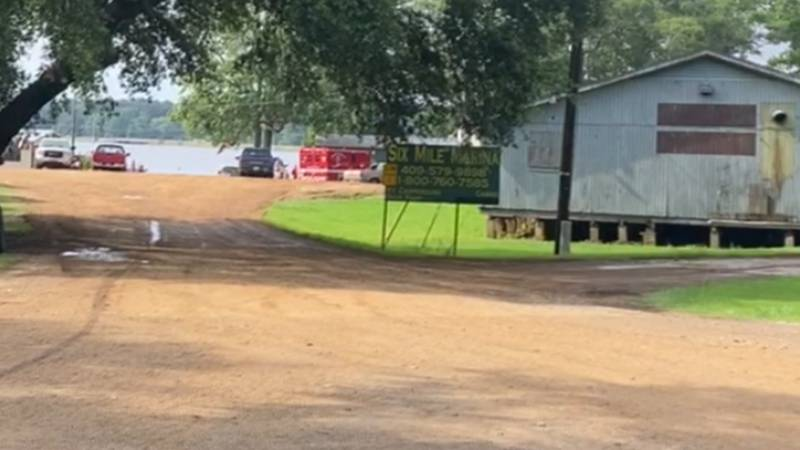 Local authorities are searching Six Mile Creek for a man who apparently fell overboard from his...