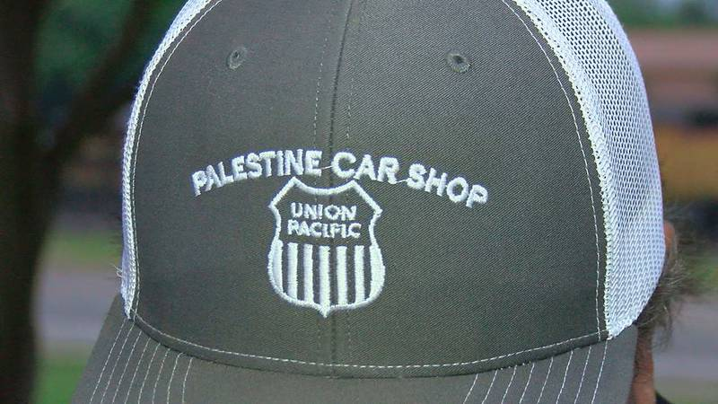A Union Pacific employee can be seen wearing a Palestine Car Shop cap.