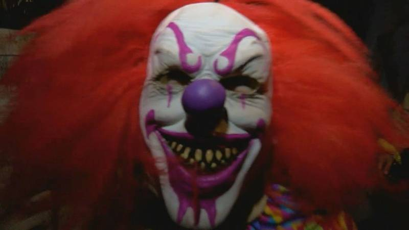 A volunteer actor performs as a scary clown at the Total Insanity HauntPark in Hudson....