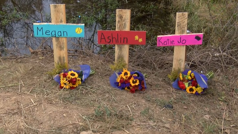 A cross memorial and flowers have been placed where a fatal crash happened on Sunday.