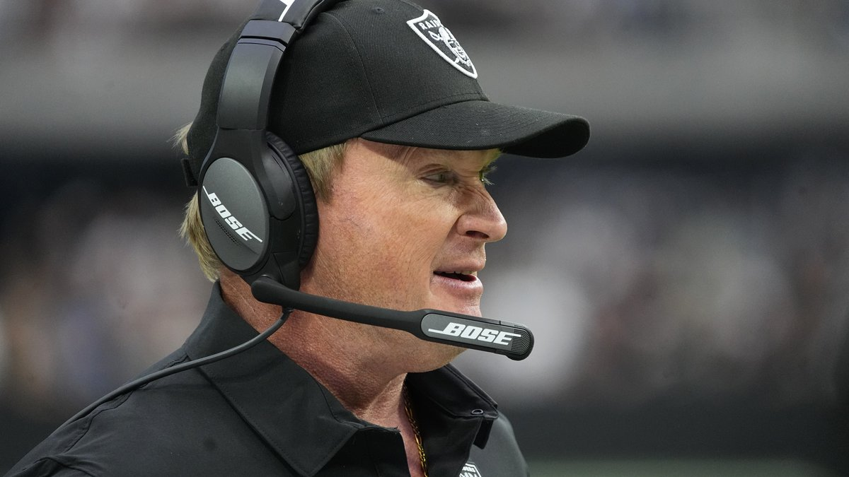 Las Vegas Raiders head coach Jon Gruden stands on the sidelines during the first half of an NFL...