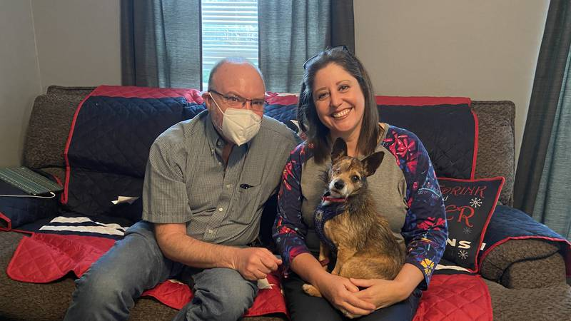 James Vasil and Rebekah Arrazate sitting with Brooks, and dog they spent almost two months...