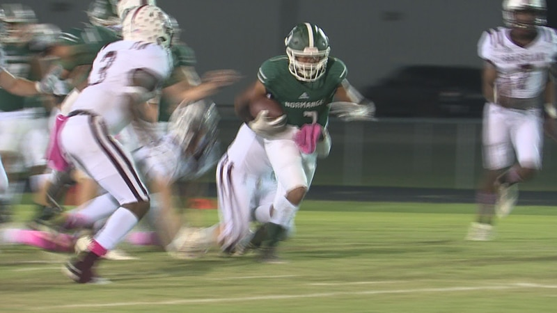 Normangee running back Caleb Haynes rushes for a first down midway through the 2nd quarter...