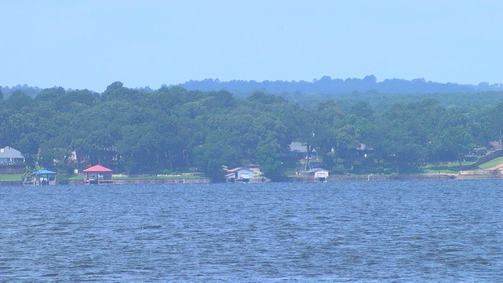 A sudden, violent storm flipped the Owens' deck boat, leaving eight people floating in Lake...