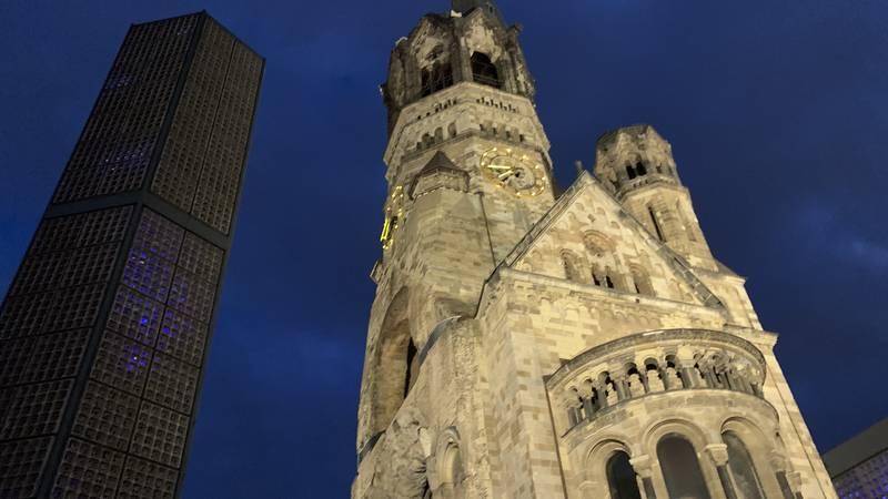 The shell of Berlin, Germany church destroyed in Allied bombings in World War II serve as...