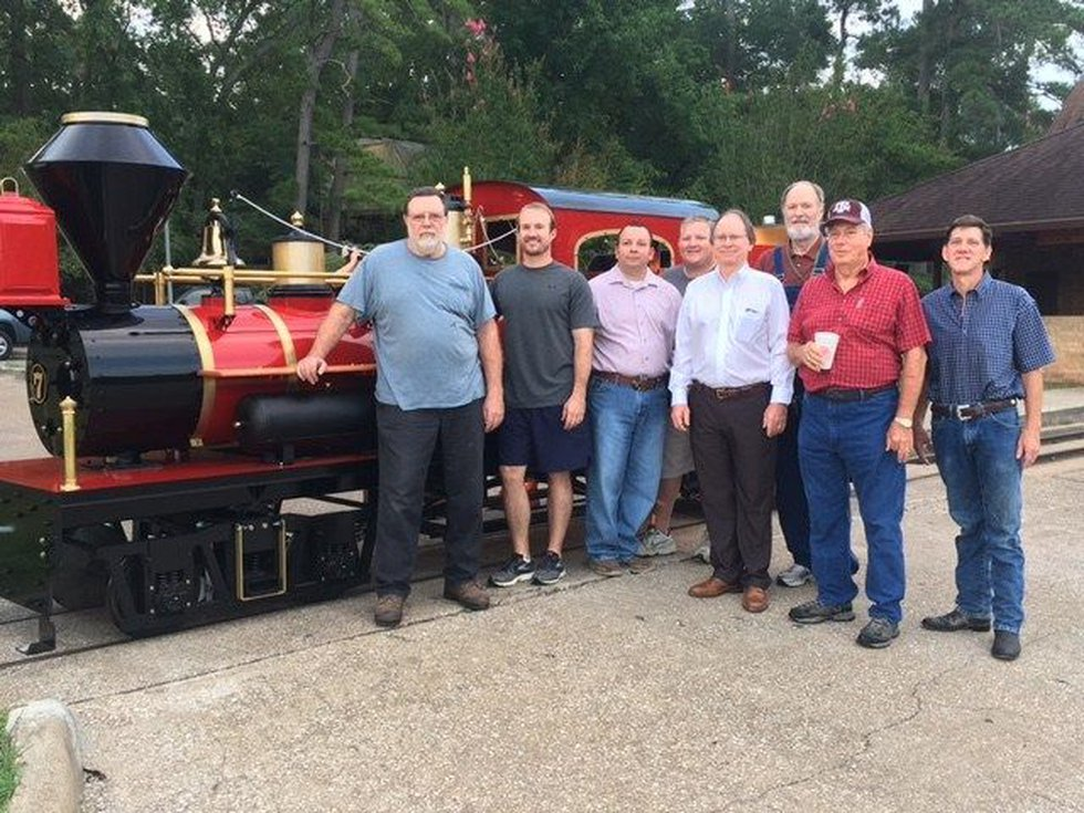 Todd Swan and Lions Club members stand in front of the new engine (Source: KTRE)
