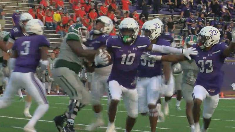 Myles Brooks returns an interception for a touchdown Saturday is SFA's 58-13 win over...
