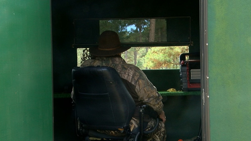 A hunter rolls into his handicap accessible stand to wait for wildlife to appear on the Winston...