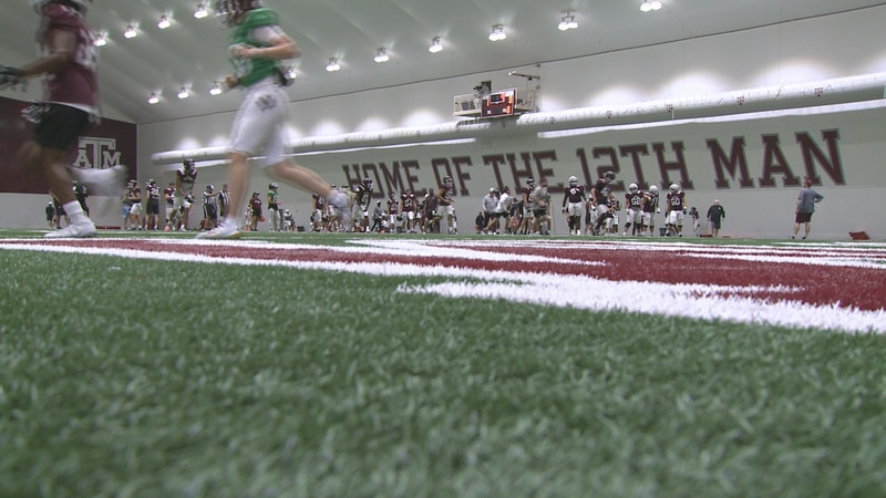 The Aggie football team practices at the indoor facility.