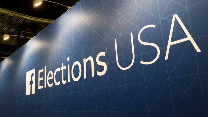 FILE- In this Aug. 6, 2015, file photo, Facebook elections signs stand in the media area in...