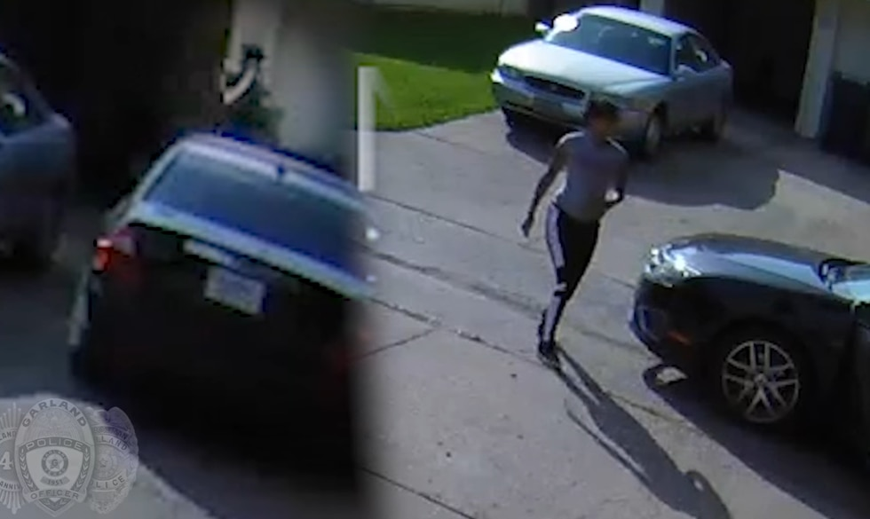 Video surveillance shows what is believed to be a black four-door vehicle behind the residence...
