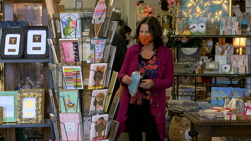 Sharon Wynne, owner of The House of Wynne Antiques and Gifts helping a customer find decor.