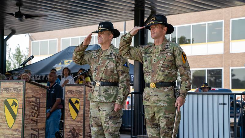 III Corps and its commander, Lt. Gen. Pat White, stands with Major General John B. Richardson...