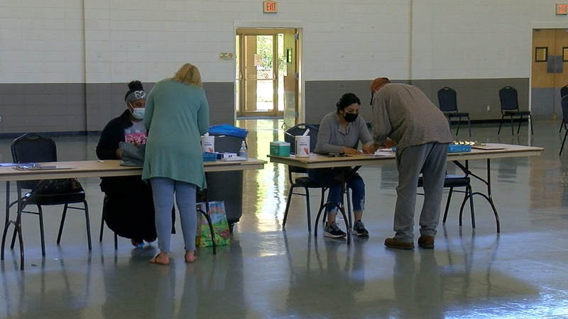 People registering for the COVID-19 vaccine clinic at Harvey Hall in Tyler.