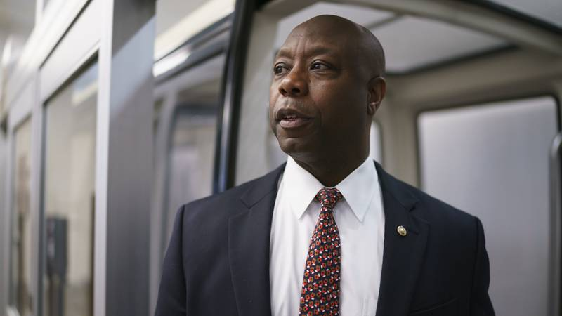 In this May 27, 2021, file photo Sen. Tim Scott, R-S.C., arrives as senators go to the chamber...