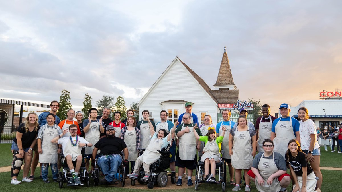 The 23 employees with special needs got the news that they had been hired by a coffee shop...