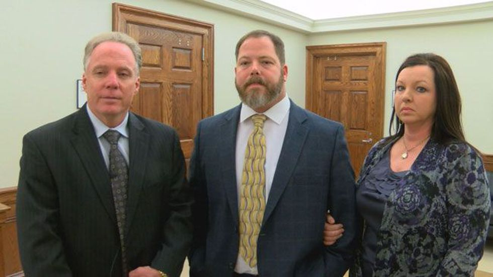 Defense attorney David Dobbs, Stephen Godfrey and his wife provide an interview following a...