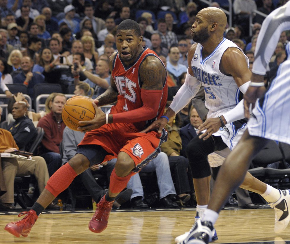 FILE - New Jersey Nets guard Terrence Williams, left, drives past Orlando Magic guard Vince...