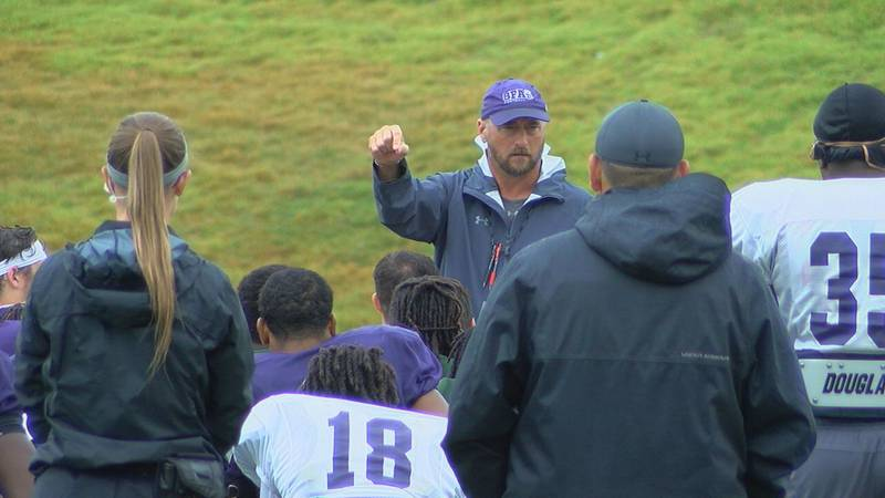 Coach Colby Carthel talks to his team following a morning practice (KTRE Sports)