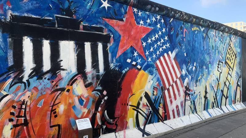 In this November 10, 2019, file photo, a mural along a section of the Berlin Wall East Side...