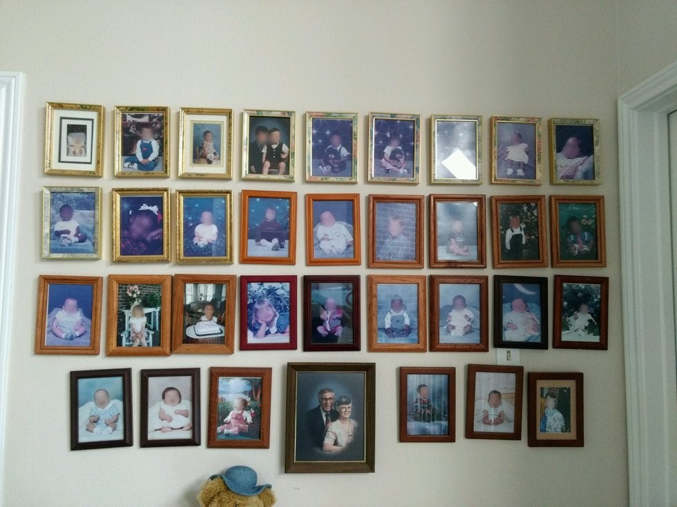 Pictures of dozens of foster children hang on the walls of Tallio's home as part of her family