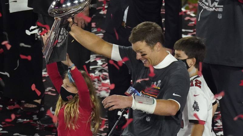 Tampa Bay Buccaneers quarterback Tom Brady, with member of his family, holds the Super Bowl...