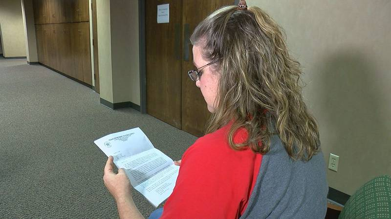 Jenni Cudd reads the letter sent to her by the Texas Department of Public Safety.