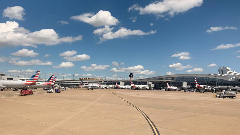 In this June 7, 2019, file photo, American Airlines aircrafts are seen parked outside a...